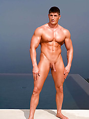 Strong bodybuilder shows his perfect body