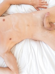 Tommy Hunter slowly strips and strokes his big thick cock.