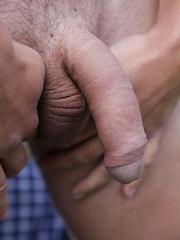 Michael strokes his hard cock in the backyard.